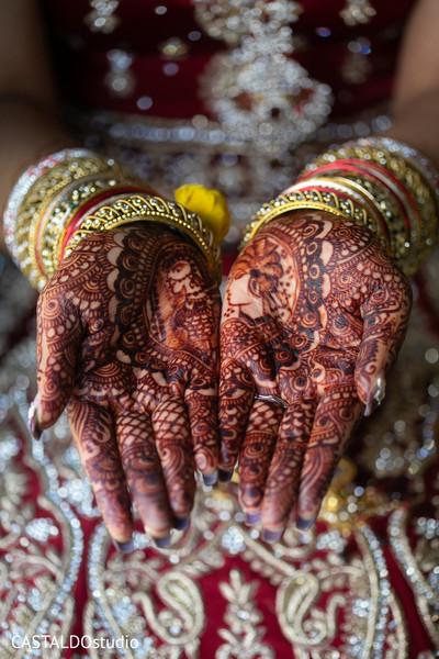 Detailed Indian bridal henna art.