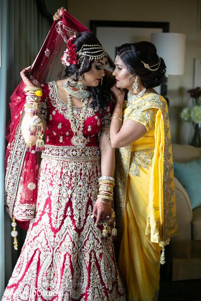 Maharani putting her wedding veil on.