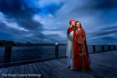 Indian bride and groom by the pier