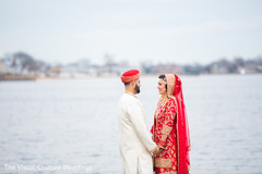 Indian bride and groom by the water