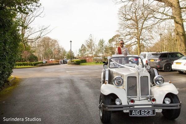 Charming Indian groom on his wedding vehicle.