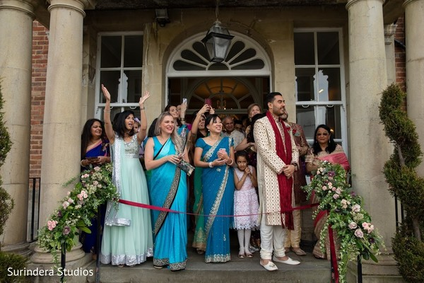Indian wedding guests waiting for groom capture.