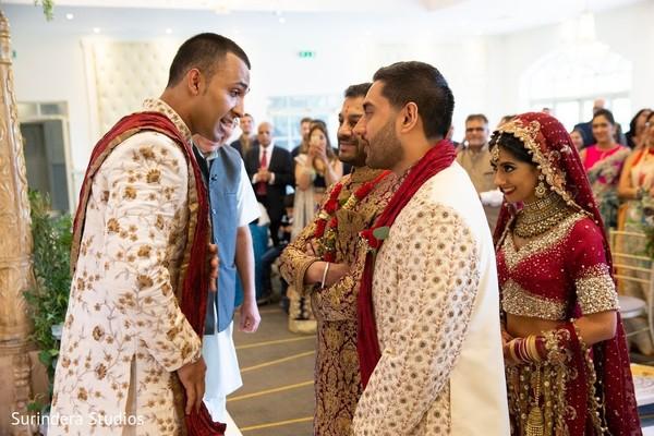 Indian groom speaking to Indian bridal guardians.