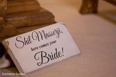 """Lovely Indian wedding """" here comes your bride"""" sign."""