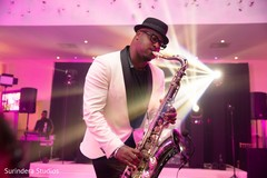 See this incredible Indian wedding saxophone player.