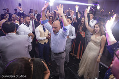 Upbeat indian wedding reception dance capture.