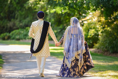 Indian bride and groom walking outside