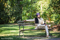Indian groom relaxing outside