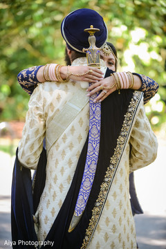 Indian bride holding the kirpan