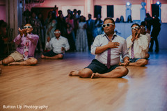 Indian wedding guests performing a fun choreography