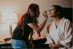 Indian bride and makeup artist