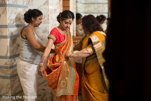 Indian bride being assisted bu special guests