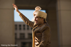 Indian groom waving at the audience