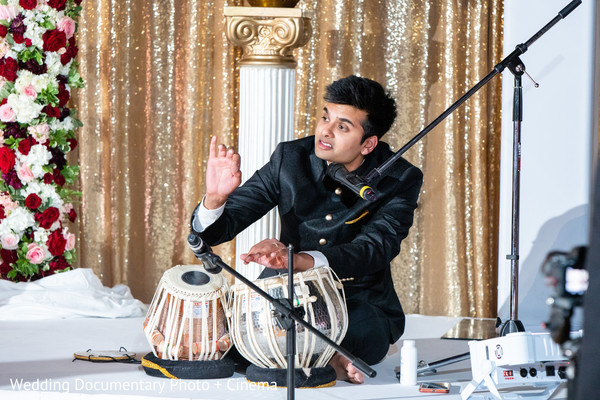 Indian groom performing during the reception