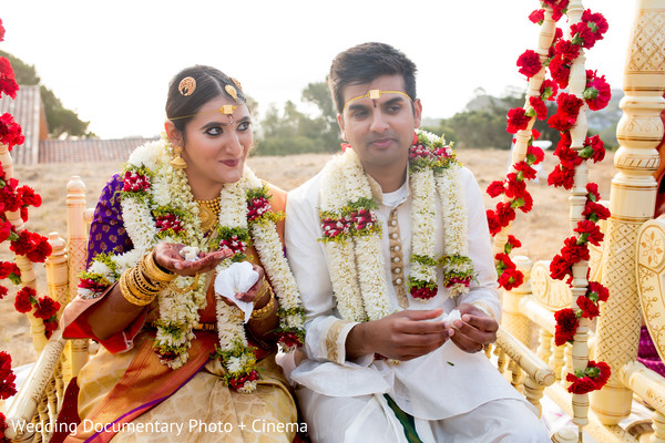 Indian bride and groom outdoors getting married