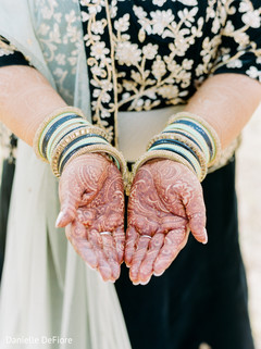 Indian bride showing her mehndi art.