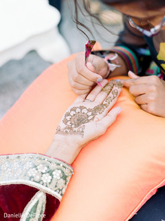 Beautiful indian bride getting her henna art done.
