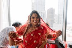 Indian bride getting her wedding attire on.
