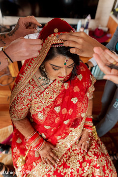 Maharani being helped to put her Ghoonghat on.