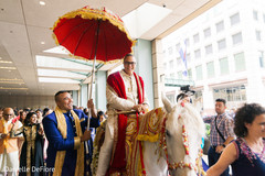 Elegant Indian groom during the Baraat celebration.