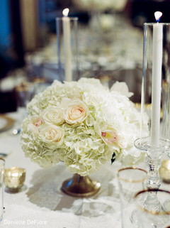 Lovely Indian wedding table centerpiece flowers decoration.