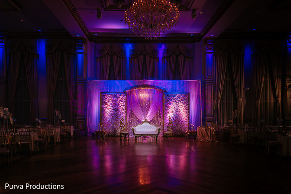 Incredible Indian wedding reception stage lights decoration.