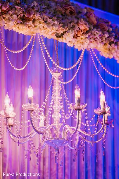 Hanging chandelier backdrop decoration.