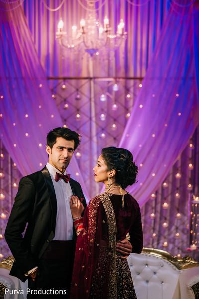 Glamorous Indian couple at  wedding photo shoot.