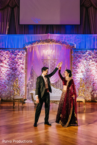 Elegant Indian couple's first dance photo.