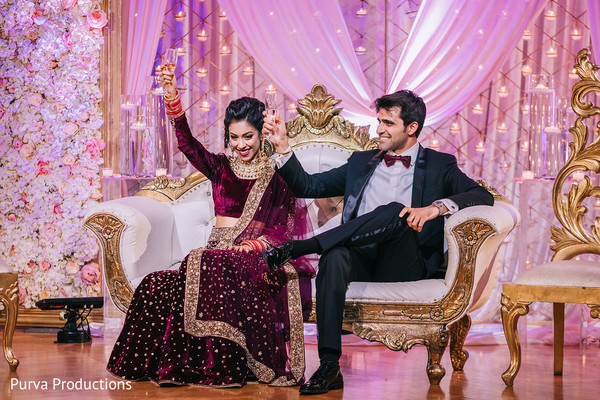 Indian couple having cheers at reception party.