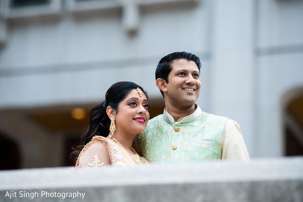 Adorable Indian bride and groom  outdoor portrait.