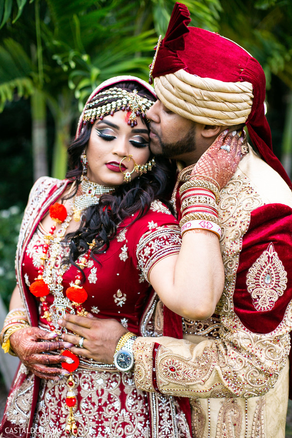 Lovely Indian couple posing for photo session.