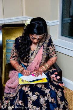 Indian bride writing a letter to groom.
