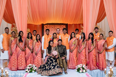 Sweet Indian couple with groomsmen and bridesmaids photo shoot.