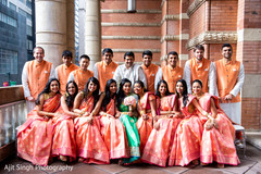Joyful Indian bride, groom, bridesmaids and groomsmen capture.