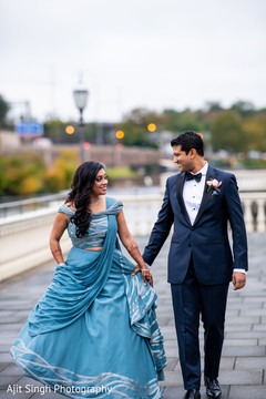 Lovely Indian  couple holding hands.