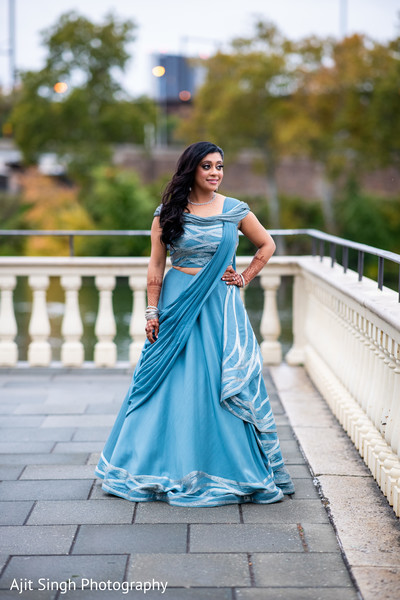 Adorable indian bride posing outdoors.