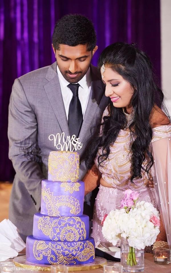 Indian couple cutting cake scene.