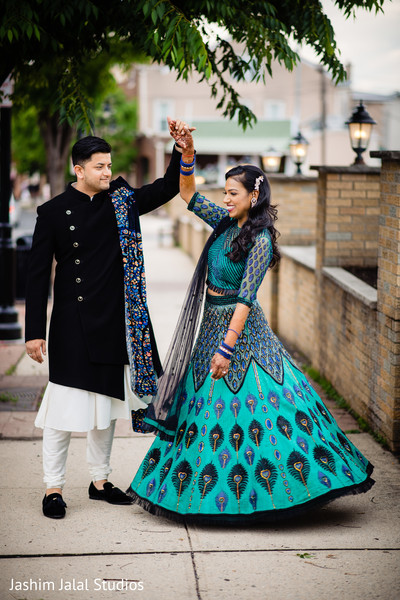 Indian bride and groom dancing outdoors