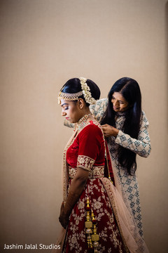 Indian bride being assisted by special guest
