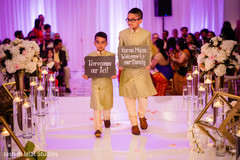 Lovely kid guests entering the ceremony