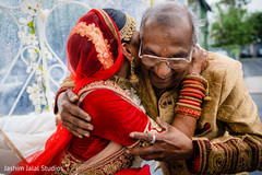 Tender moment between the bride and family