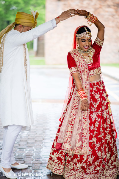 Indian bride and groom having fun during the photo shoot