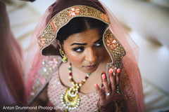 Indian bride posing with lengha outfit