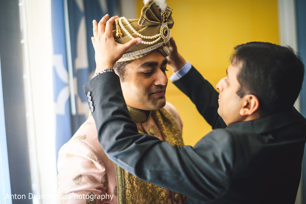 Indian groom being assisted by special guest