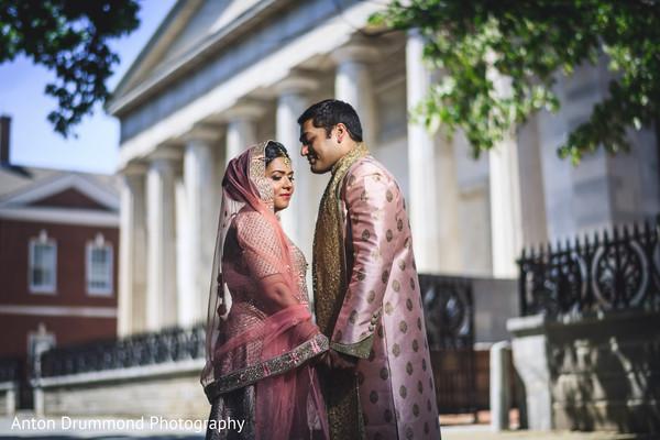 Indian groom holding Maharani's hands
