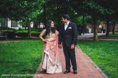 Indian bride and groom walking outdoors