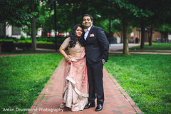 Indian bride and groom posing for the photo shoot