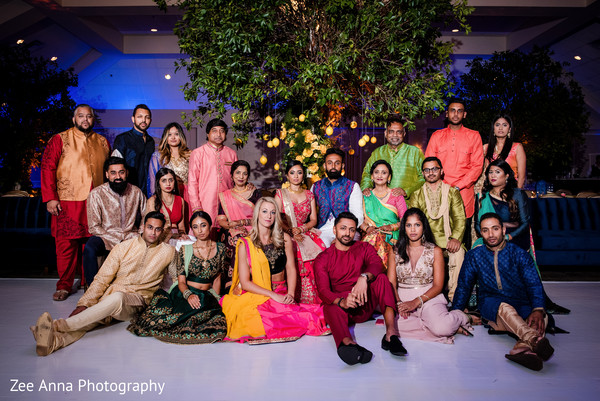 Indian bride, groom, bridesmaids and groomsmen sangeet photo.