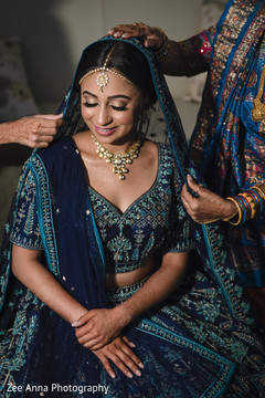 Lovely Indian bride getting her ghoonghat on.